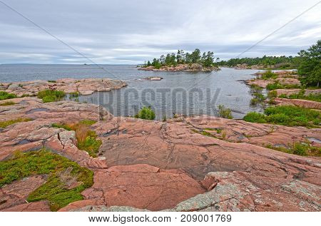 Looking out to Open Water on a Remote Lake Shore on Georgian Bay of Lake Huron on the Chikanishing Trail in Killarney Provincial Park in Ontario
