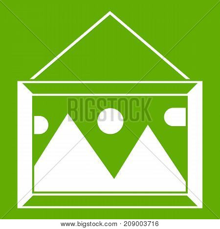 Picture in a frame on the wall icon white isolated on green background. Vector illustration