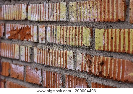 Texture red brick wall of the garage