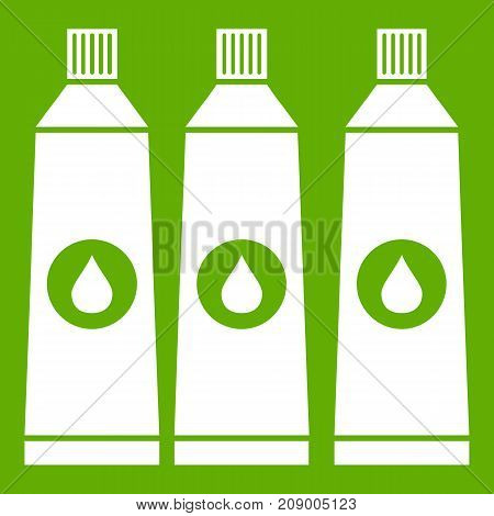 Three tubes with paint icon white isolated on green background. Vector illustration