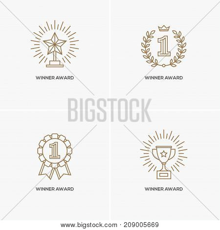 Set of four linear awards: trophy or winner cup star and medal with number one. Victory success achievement symbol logo design element. Contest gold winner sport champion emblem.