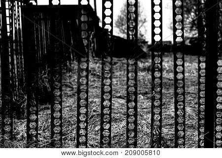 The texture of the metal doors in the garage black and white poster