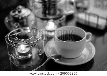 Tea ceremony in the dining candlelight black and white poster
