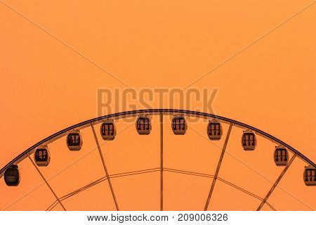 Ferris wheel on golden background vintage color with sunset background Colorful vintage retro ferris wheel on orange sky Thailand