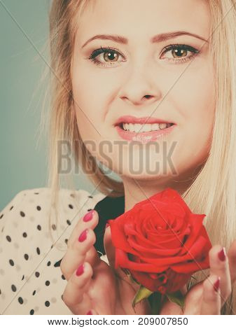 Woman Holding Red Rose Flower On Blue