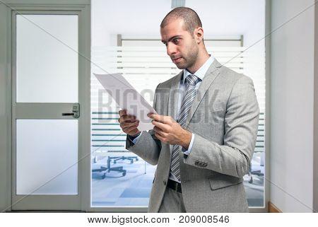 Concerned businessman reading a document