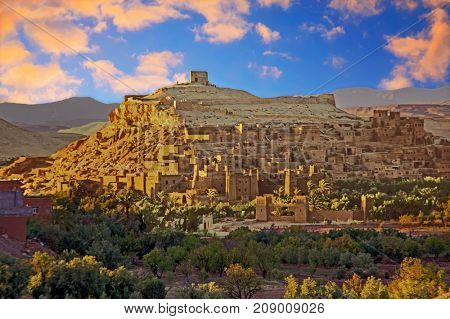 The fortified town of Ait ben Haddou near Ouarzazate Morocco on the edge of the sahara desert in Morocco at sunset. Famous for its use as a set in many films such as Lawrence of Arabia, Gladiator