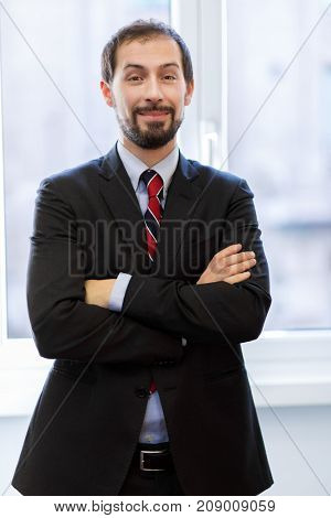 Smiling manager in his office
