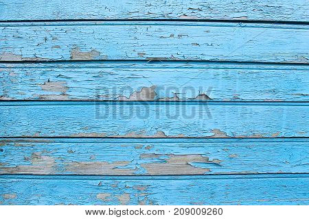 Texture of old painted wooden wall of the house