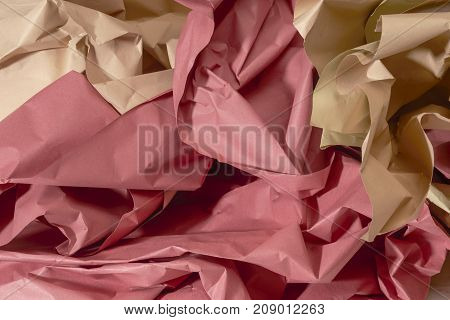 full frame red and brown crumpled paper background