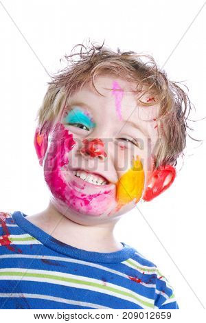 Smiling small boy with painted face