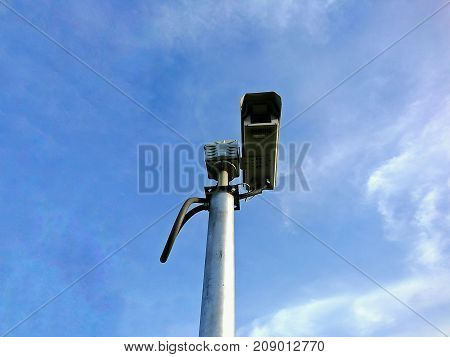 CCTV camera with a blue sky background for concept of security technology.