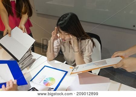 Office woman feeling headache and exhausted in her office