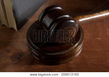 Wooden judge's hammer on a brown wooden background
