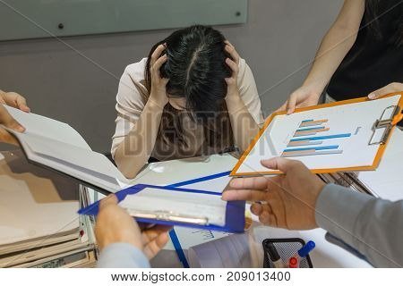 The manager tired of reading report and signing document