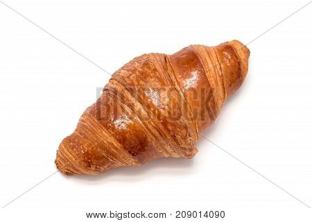 Fresh croissant isolated on a white background top view