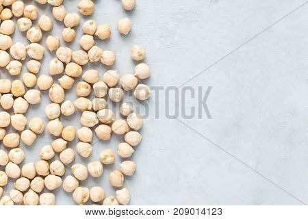 Uncooked dry chickpeas on concrete background horizontal copy space closeup