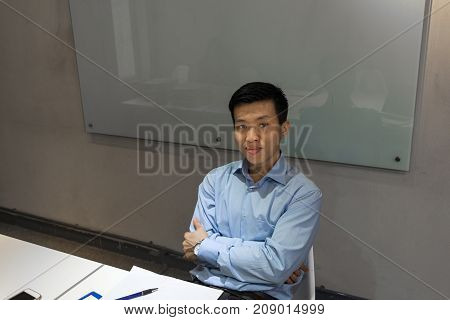 Portrait of successful Asian businessman in the meeting rooom