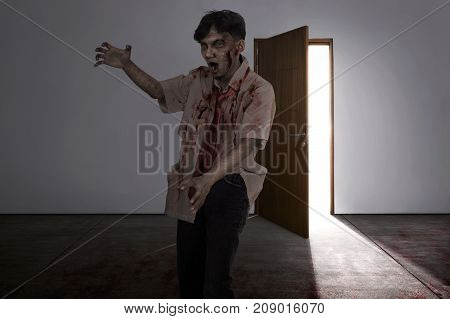 Aggressive Asian Zombie Man With Wounded Face