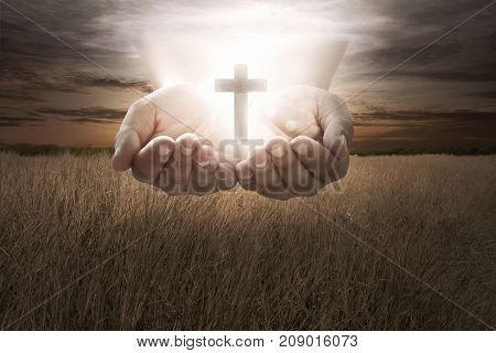 Human Hand Hold Christian Cross