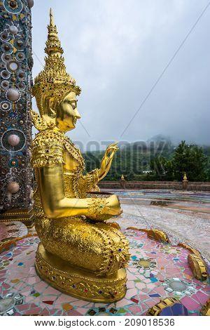 Outdoor Golden Buddha Image in beautiful Buddhist temple Wat Phasornkaeo where Buddhist to worship in Petchabun Thailand