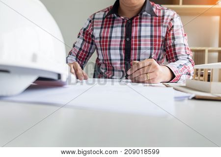 Person's Engineer Hand Drawing Plan On Blue Print Or Working Project In His Office With Architect Eq