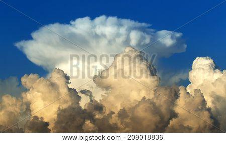 A big cumulonimbus cloud in the blue sky