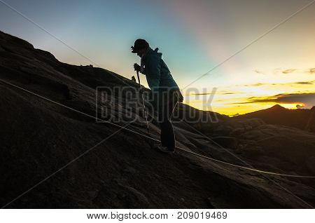 Mount Kinabalu,Ranau,Sabah.Malaysia-March 12,2016:Silhouette climber passing trail to the summit of Mountain Kinabalu during sunrise in Mount Kinabalu,Sabah,Malaysia.