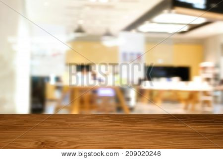 Empty Top Of Wooden Table Or Counter On Abstract Blurry Of People Walking And Test Mobile Phone Shop