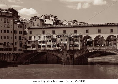 Ponte Vecchio over Arno River in Florence Italy black and white.