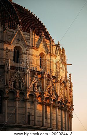 Pisa Piazza dei Miracoli and church dome closeup view with beautiful pattern  in Italy at sunset