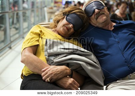 Caucasian couple is napping at the airport
