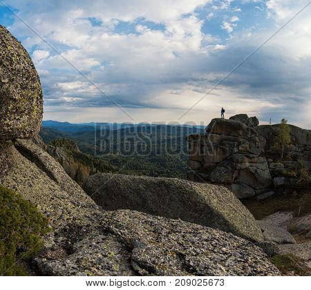 Man on the peak of mountains of Altai. Kolyvan range - a mountain range in the north-west of the Altai Mountains, in the Altai Territory, Russia