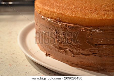 Chocolate cake in cake form on wooden background, Baking chocolate cake