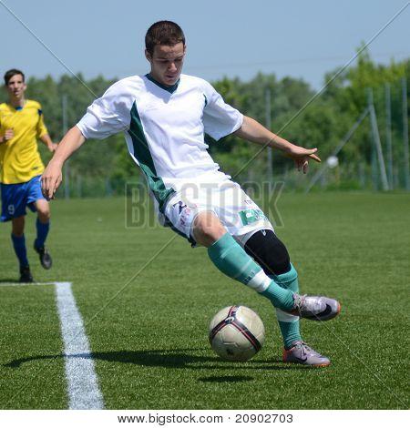 KAPOSVAR, HUNGARY - JUNE 11: Balazs Szili (in white) in action at the Hungarian National Championship under 13 game between Kaposvari Rakoczi FC and Bajai LSE June 11, 2011 in Kaposvar, Hungary.