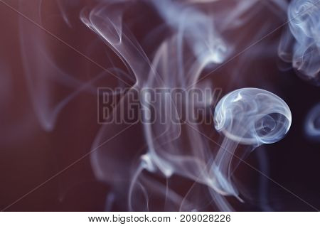 The smoke from the incense sticks. Abstract art. Soft focus.