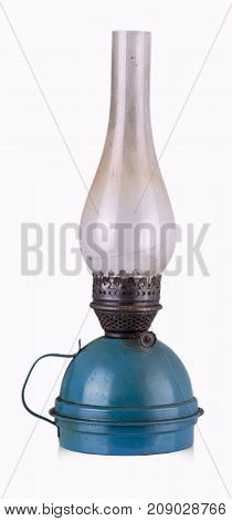The old shabby kerosene lamp. The lamp of past times. Isolated. On a white background