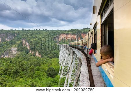 Hsipaw, Myanmar - October 4, 2016: Train passing the famous viaduct Goteik between Pyin Oo Lwin and Hsipaw in Myanmar
