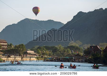 Vang Vieng, Laos - January 19, 2017: Hot air baloon in sky in Vang Vieng, Laos.