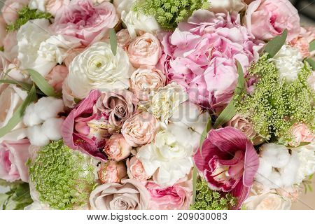 Luxury bouquets of mix flowers in the hat box. copy space. Flowers on all photos