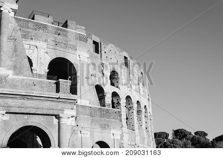 Outdoor view of The Colosseum or Coliseum, also known as the Flavian Amphitheatre. Black and white image