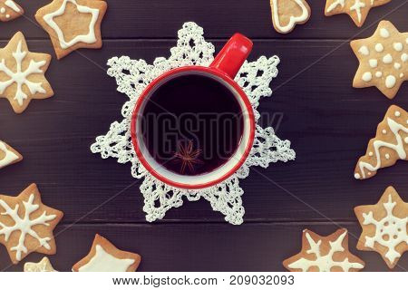 red mug with drink surrounded by figured liver top view / holiday table for the winter holidays