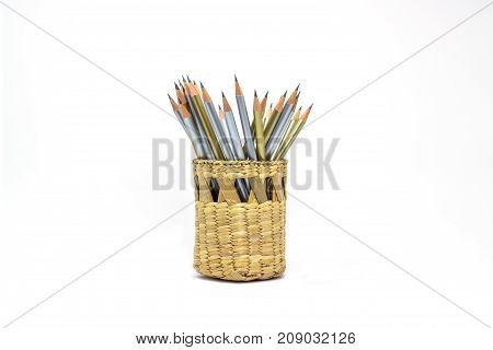 Golden pencil and silver in basket isolated from white background.