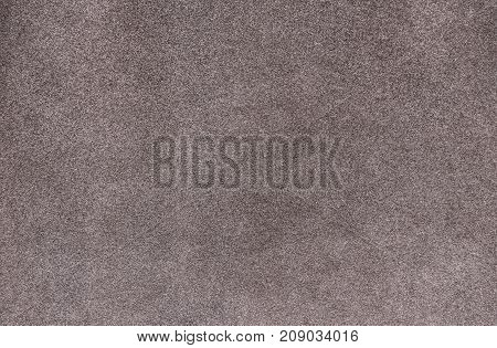 Plain gray color carpet texture. Pale smooth carpet. Velvet paper background.