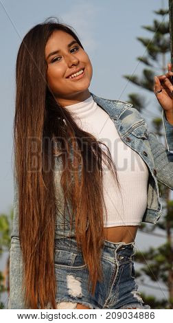 A Teen Outdoors With Long Brunette Hair