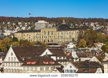 Zurich, Switzerland - 15 October, 2017: buildings of the city of Zurich as seen from the Lindenhof park. Zurich is the largest city in Switzerland and the capital of the Swiss canton of Zurich.