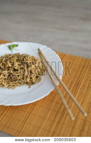Noodles With Beef In Plate With Bamboo Stic