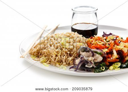 Rice dish with goulash on white background