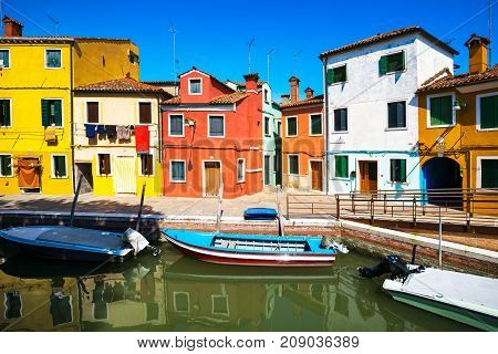 Venice landmark Burano island canal colorful houses and boats Italy Europe