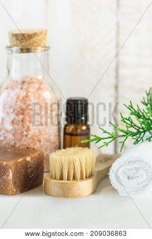 Handmade Coal Tar Soap Pink Himalayan Salt Essential Oil Towel Brush Juniper Twig on White Marble Background. Spa Wellness Relaxation Body Care Skincare Concept. Natural Products